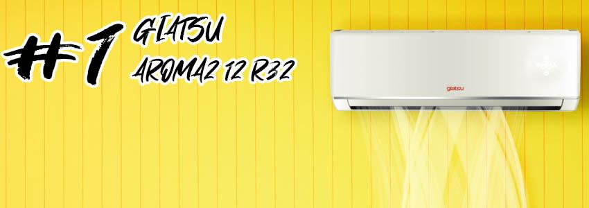 Se muestra un Split Giatsu AROMA 2 12 con gas R32 en una pared amarilla.